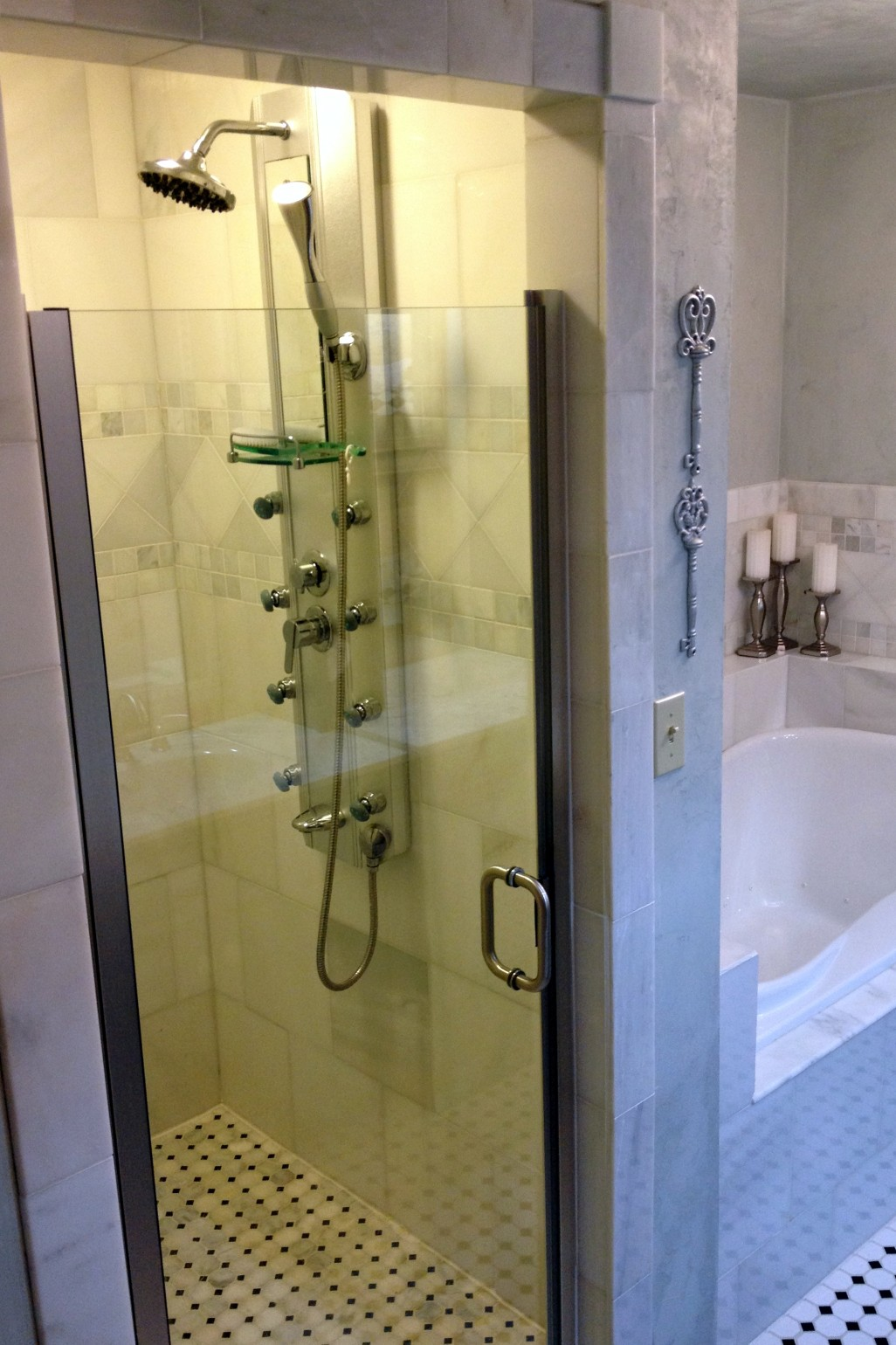 Walk in shower and part of bubble tub for 2 queen room.